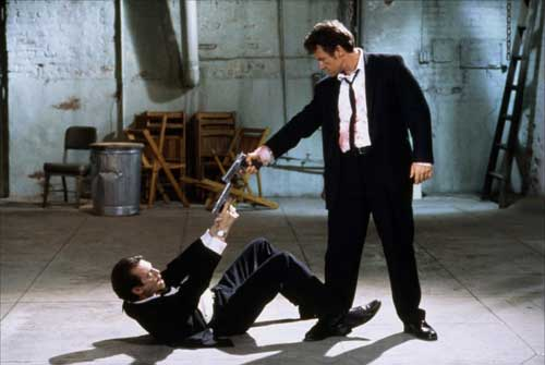 Harvey Keitel and Steve Buscemi pointing guns at each other in Reservoir Dogs