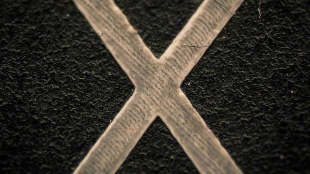 "Extreme Close-Up - ""X"" key from a keyboard"